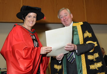 RCSI Recipient Receiving Her Parchment from NUI Chancellor Dr Maurince Manning