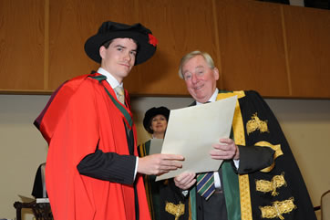RCSI Recipient Receiving His Parchment from NUI Chancellor Dr Maurince Manning