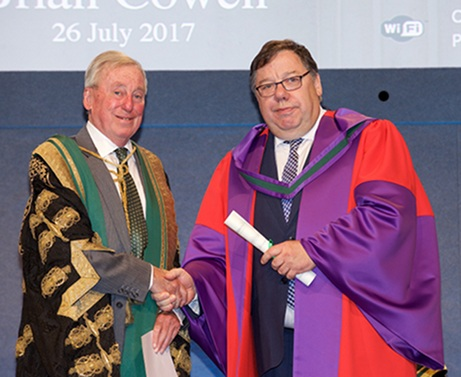 NUI Chancellor Presenting Dr Brian Cowen Honorary Conferring with his honorary Doctor of Laws Degree