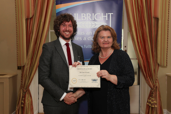 Dr Cian O'Leary, RCSI (L) receiving his award from Fulbright Commission Board Chairperson, Dr Sarah Ingle at the 2018 Fulbright Awards Ceremony in the U.S. Ambassador's Residence, Deerpark, Dublin.