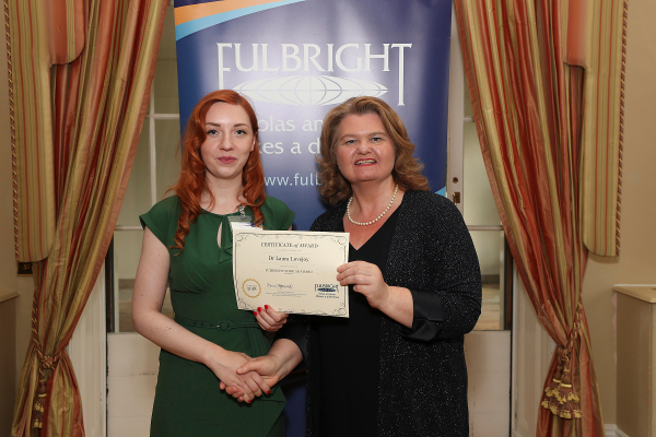 Dr Laura Lovejoy, UCC (L) receiving her award from Fulbright Commission Board Chairperson, Dr Sarah Ingle at the 2018 Fulbright Awards Ceremony in the U.S. Ambassador's Residence, Deerpark, Dublin.